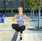 women in yoga position balancing on a cell phone